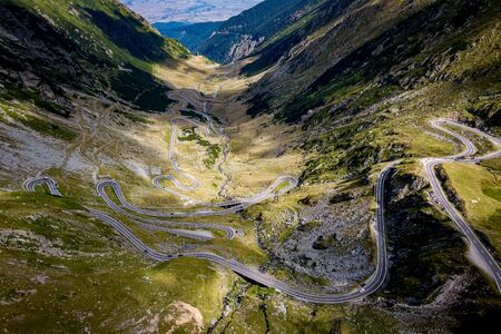 Winding mountain road. Transfagarasan is one of the most spectacular mountain roads in the world. Romania Standard-Bild - 129483816