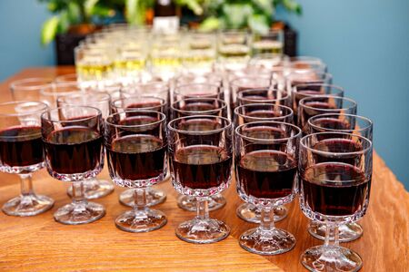 Glasses with wine on a banquet table
