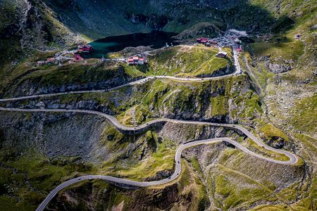 Winding mountain highway. Shot from drone Standard-Bild - 129484749