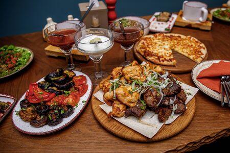 Set of Georgian food. Skewers of chicken and pork.