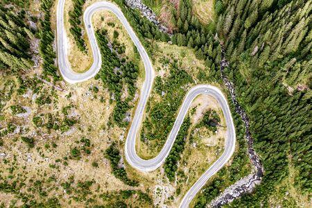 Winding mountain highway. Shot from drone Standard-Bild - 129484735