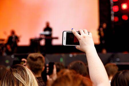 Video recording on a mobile phone, concert show Standard-Bild - 129484671