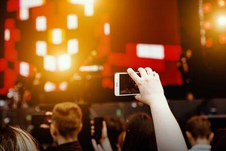 Video recording on a mobile phone, concert show Standard-Bild - 129484672
