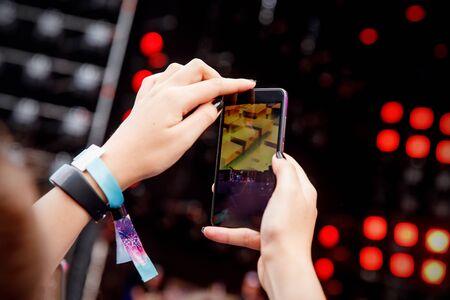 Video recording on a mobile phone, concert show Standard-Bild - 129484649