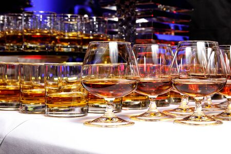 Elegant glasses with alcohol at the party Imagens