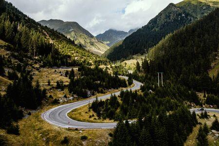 Turns of the road around beautiful nature Фото со стока