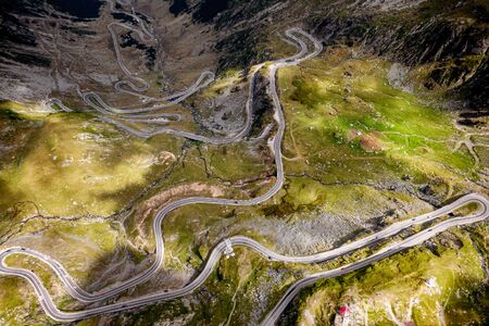 Aerial top view of serpentine narrow road. A road full of twists and turns winding. Romania Stock fotó