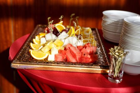 Fruits on a plate at the event. Sunlight