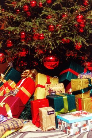 Holiday gifts under christmas tree