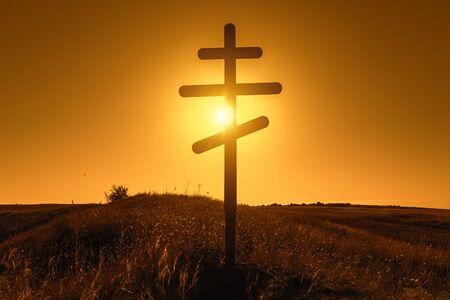 Silhouette of Christian Orthodox cross on sunset Stock Photo