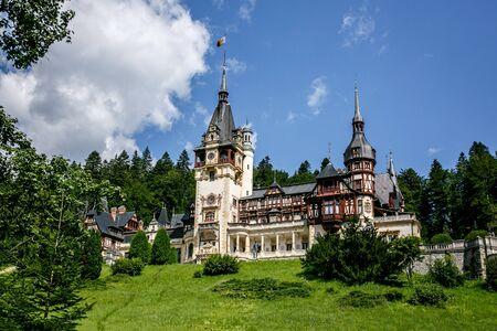 Peles castle in Romania, Europe. Blue sky, green grass, summer time