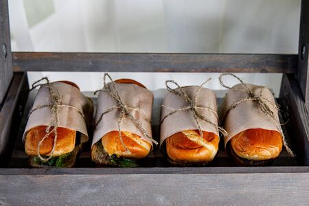 Sandwiches on event catering. Street food ready to serve on a food stall.