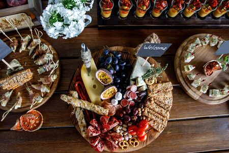 Summer party snacks on wooden table