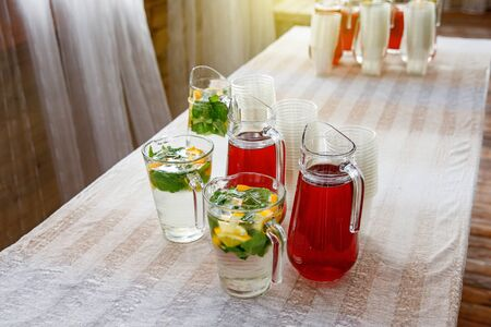 Jugs of lemonade at the summer outdoor party