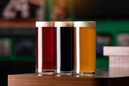 Different types of beer at the bar. Stockfoto
