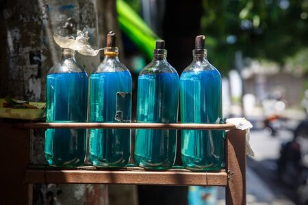 Bottles of gasoline petrol on Bali street Stock Photo