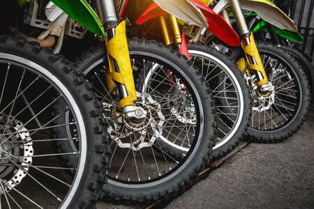 Front wheels of motorcycles stand in a row