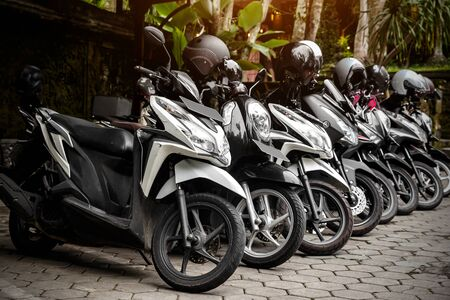 Motorcycles group parking on city street during adventure journey. Motorcyclists community travel concept. Stock Photo