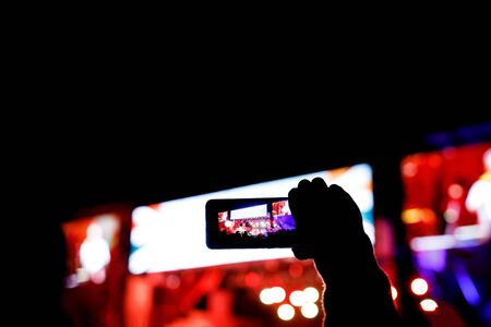 Silhouette of a smartphone in the hands. Stage record video