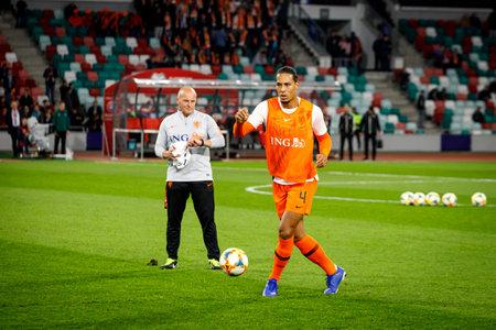 Minsk, Belarus - October 13, 2019 : UEFA European Qualifiers 2020. Virgil van Dijk at the warm-up before the match. Smiles