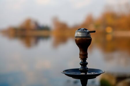 Top of hookah on nature. Sunset time and lake on background Stock fotó