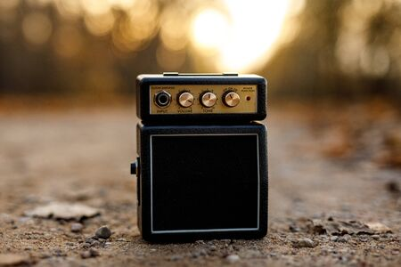 Guitar amp with orange nature background