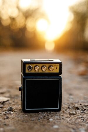 Guitar amp with orange nature background