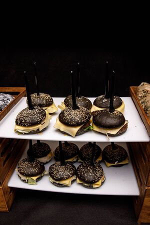 Black burgers on event catering