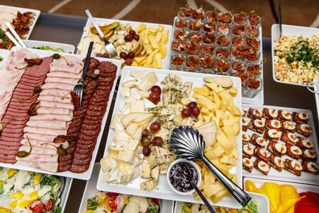 Cheese plate with other snacks on a banquet table 写真素材
