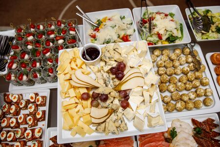Cheese plate with other snacks on a banquet table Stok Fotoğraf