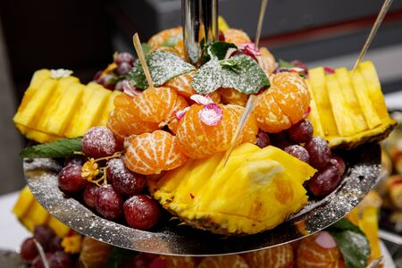 Different fruits on a multi-story tray, Event catering