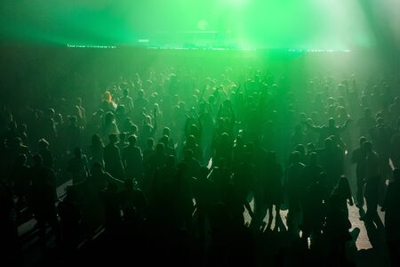 Silhouette of crowd. Raised hands on concert, music show