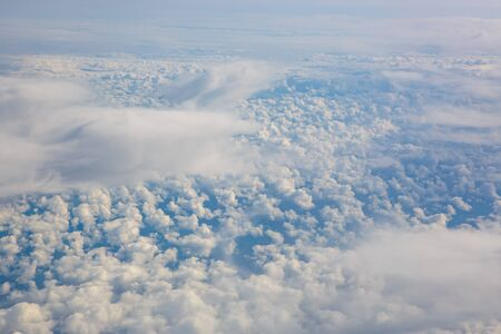 Blue sky from airplane. View above the clouds