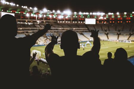 Football, soccer fan support their team and celebrate goal, score, victory. Black silhouette Stock Photo