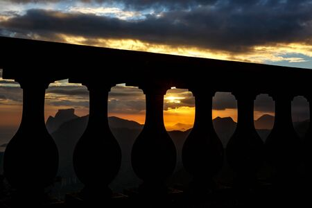 Black silhouette of Balustrade on sunset and mountain line backgound.