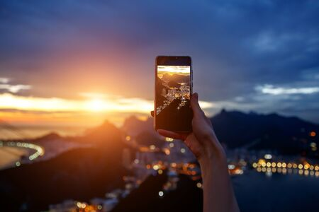 Taking a photo on a mobile phone camera of Rio de Janeiro, Brasil 写真素材