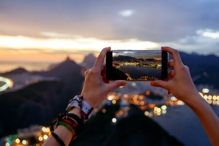 Taking a photo on a mobile phone camera of Rio de Janeiro, Brasil.