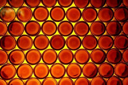Background of bottoms of orange bottles.