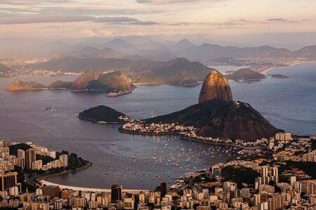 Sunset view of mountain Sugar Loaf and Botafogo. Rio de Janeiro, Brazil Imagens