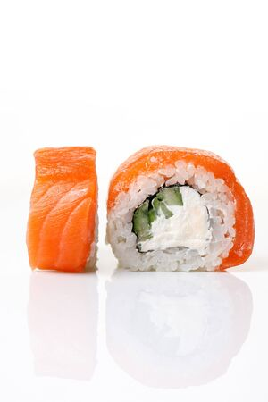 Philadelphia sushi roll on an isolated white background with reflection