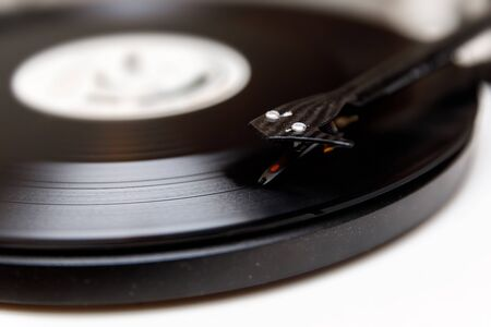 A needle playing an old vinyl. Close-up view