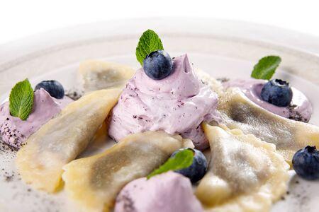 Blueberry cream dumplings on a white plate