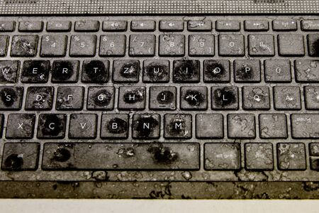 Old damaged and dirty keyboard