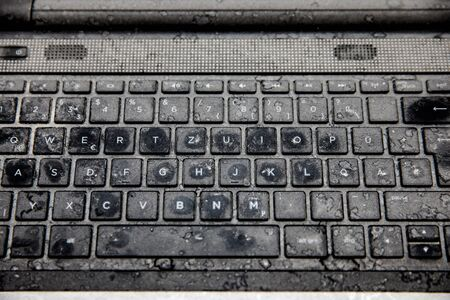 Old dirty black keyboard with dust and blots Reklamní fotografie