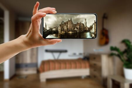 Online trip to European old town Brugge in Belgium using a smartphone at home