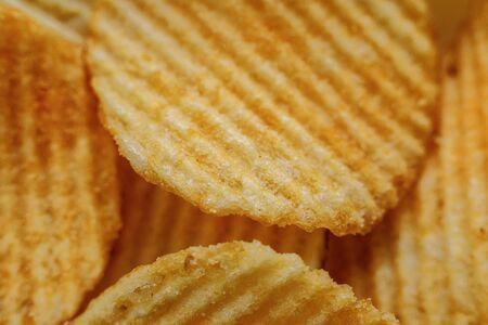 Corrugated Potato Chips. Close-up macro view