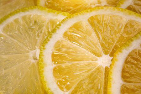 Lemon background. Close up view of lemon slices. Citrus texture