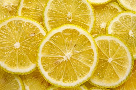 Lemon background. Top view of round slices
