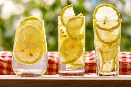 Three glasses of lemon water on the sunny garden background Stock fotó