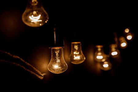 A row of light bulbs. Focus on the closest